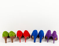 Suede stiletto shoes lined up Stock Photo