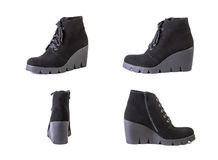 Suede women's boots on a white background, black shoes, autumn a Stock Photography