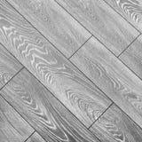 Suelo de la lamina gris Suelo laminado gris elegante con el modelo de madera natural fuerte foto de archivo