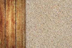Suelo de madera con el fondo de la arena Foto de archivo libre de regalías