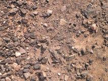 Suelo y rocas como fondo Foto de archivo libre de regalías