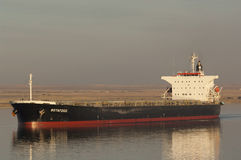 SUEZ CANAL/EGYPT - 3rd JANUARY 2007 - The Bulk Carrier Botafogo. Passes north through Great Bitter Lake at sunset stock image