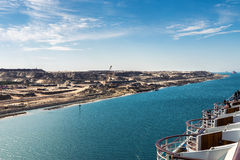 The Suez Canal - a ship convoy with a cruise ship passes the new Stock Image