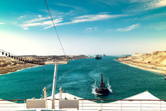 The Suez Canal - a ship convoy with a cruise ship passes through Royalty Free Stock Image