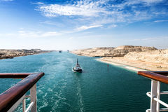 The Suez Canal - a ship convoy with a cruise ship passes through Royalty Free Stock Photo