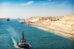 The Suez Canal - a ship convoy passes through the new eastern ex Stock Images