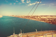 The Suez Canal - a ship drives in the new eastern extension cana Stock Images