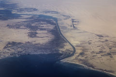 Suez canal. View from airplane of Suez Canal and seaport Suez in Egypt royalty free stock photo