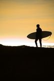 Sufer and the Sunset and the Pacific Ocean Stock Photography