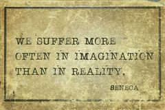 We suffer Seneca. We suffer more often in imagination - ancient Roman philosopher Seneca quote printed on grunge vintage cardboard Stock Images