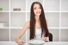 Suffering from anorexia. Image of girl trying to put a pea on th stock photos
