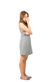 Suffering Asian Female Headache Congestion Full. Profile of frowning migraine sufferer Asian woman in sleeveless gray dress holding bridge of nose suffereing Royalty Free Stock Images