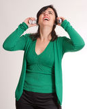 Suffering brunette talking with two phones Stock Photos