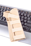 Suffering from Carpal Tunnel. With Wrist Brace stock images