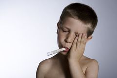 Suffering child with thermometer Royalty Free Stock Images