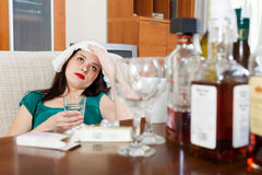 Suffering girl with glass of water Stock Image