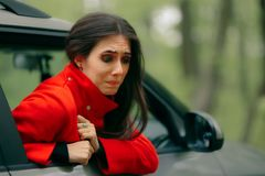 Car Sick Woman Having Motion Sickness Symptoms. Suffering girl in a pulled over automobile trying to recover from travel sickness stock image