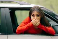 Car Sick Woman Having Motion Sickness Symptoms. Suffering girl in a pulled over automobile trying to recover from travel sickness royalty free stock photo