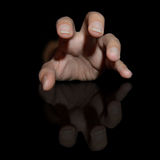 Suffering hand on a black background Royalty Free Stock Image