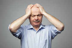 Suffering from a headache, or a multitude of problems Stock Photo
