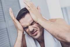 Suffering man feeling severe headache royalty free stock photo