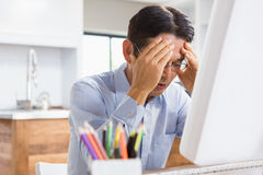 Suffering man with hands on face Royalty Free Stock Photo