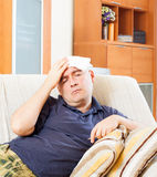 Suffering  man in plaid stupes  towel Stock Photography