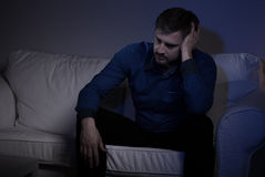 Suffering man secluded from society Stock Photos
