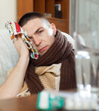 Suffering man   stuping  towel to head Stock Images