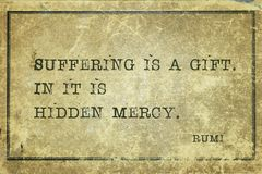 Suffering mercy Rumi. Suffering is a gift. In it is hidden mercy - famous ancient Greek comic playwright Aristophanes quote printed on grunge vintage cardboard Stock Photography