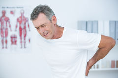 Suffering patient touching his back Royalty Free Stock Image