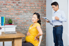 Suffering pregnant woman sitting on chair Royalty Free Stock Photo