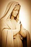 Suffering religious woman praying. Vintage sepia image of a suffering religious woman praying Stock Photography