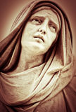 Suffering religious woman statue Royalty Free Stock Image