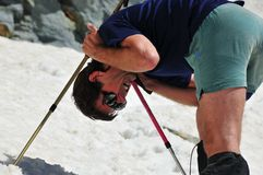 Suffering from Sunstroke. A climber suffering from sunstroke on a glacier. He was vomiting and cramping every few minutes, and had lost all his energy, and Royalty Free Stock Images