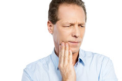 Suffering from toothache. stock photos