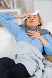 Suffering woman holding head Stock Photography