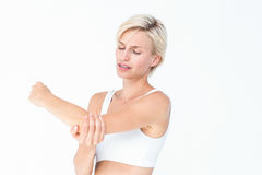 Suffering woman touching her sore elbow Stock Photos