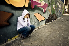 Suffering woman on wall Stock Photography