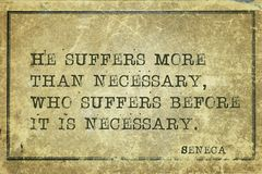 Suffers more Seneca. He suffers more than necessary, who suffers before - ancient Roman philosopher Seneca quote printed on grunge vintage cardboard Royalty Free Stock Images