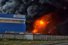 The suffocating smoke and soot in fires. In St. Petersburg Parnas industrial zone in the warehouse of the fifth degree of difficulty Royalty Free Stock Images