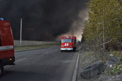 The suffocating smoke and soot in fires. In St. Petersburg Parnas industrial zone in the warehouse of the fifth degree of difficulty Stock Photos
