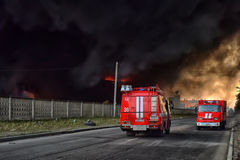 The suffocating smoke and soot in fires. In St. Petersburg Parnas industrial zone in the warehouse of the fifth degree of difficulty Stock Image