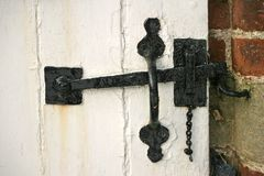 Suffolk Latch. Old fashioned latch on stable door royalty free stock image