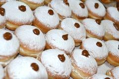 Sufganiya - donut. Hanukkah doughnut with jam and caster sugar Royalty Free Stock Photography