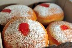 Sufganiyot. Fresh sufganiyot in a cardboard box for the Jewish holiday of Hanukkah Stock Images