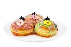 Sufganiyot - donuts med blommor Royaltyfria Foton