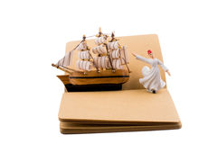 Sufi Dervish and a ship on a notebook Stock Photos