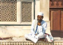Sufi Muslim Cleric studies outside the Jama Mashid Mosque. FATEHPUR SIKRI, INDIA - CIRCA FEBRUARY 2011: Sitting Sufi Muslim Cleric studies outside the Jama stock image
