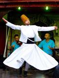 Sufi whirling dervish. (Semazen) dances at Sultanahmet during holy month of Ramadan on July 25, 2012 in Istanbul. Semazen conveys God's spiritual gift to those Royalty Free Stock Photography